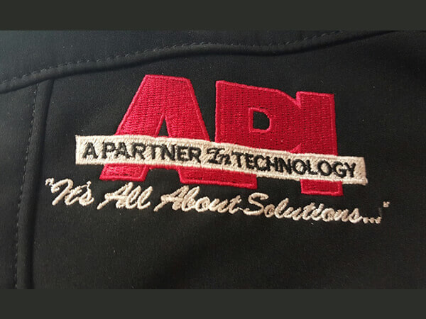 API Technology embroidered logo on jacket by D R Designs, LLC.