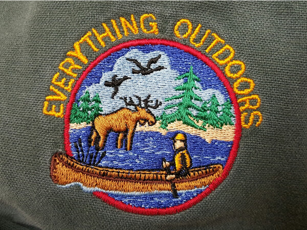 Everything Outdoors embroidered logo on jacket