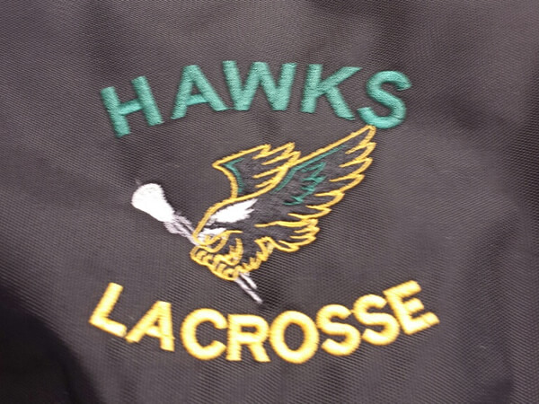 Hawks Lacrosse logo embroidered by D R Designs, LLC.