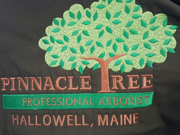 Pinnacle Tree embroidered logo by D R Designs, LLC.
