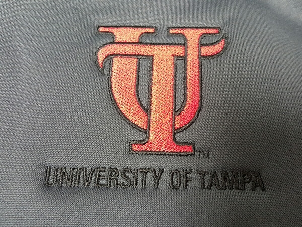 University of Tampa embroidered logo by D R Designs, LLC.